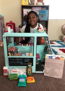 iLEAD Antelope Valley learner with toy truck