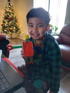iLEAD Antelope Valley learner holding robot he made