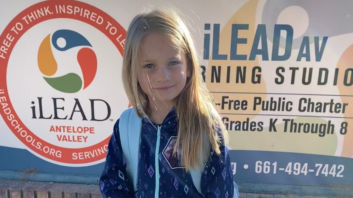 iLEAD Antelope Valley learner on campus with iLEAD sign